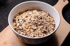 Oatmeal on the wooden background (wuestenigel) Tags: wood dry natural concept oats grain background healthy diet plant vegetarian flake oat pile cereal health isolated porridge white wheat spoon wooden oatmeal flakes nutrition table ingredient breakfast seed raw bowl rolled heap nobody food meal organic