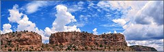 On the Way to Santa Fe (Sugardxn) Tags: garypentin sugardxn canon canoneos20d canon20d photoshop picswithframes frame newmexico nm arizona az panorama mountain clouds bluesky outdoor sky redrock