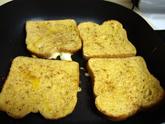 French Toast In The Pan. (dccradio) Tags: lumberton nc northcarolina robesoncounty food eat breakfast meal bread frenchtoast indoors sony cybershot w230