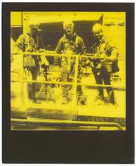 Ready for the take off (Giorgio Verdiani) Tags: polaroid sx70 landcamera supercolorautofocus model2 impossible blackandyellow gialloenero instant istantanea fotografia picture film pellicola fortedeimarmi pontile sea mare surfers surfisti waves onde sole sun water acqua