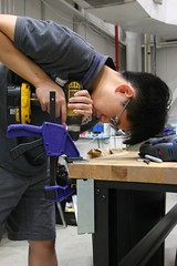 "Bryce carefully cuts corners and drills out steel support brackets • <a style=""font-size:0.8em;"" href=""http://www.flickr.com/photos/27717602@N03/34416463013/"" target=""_blank"">View on Flickr</a>"