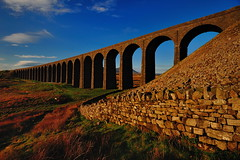Twenty four (images@twiston) Tags: twenty four sunrise ribblehead viaduct ribbleheadviaduct settle carlisle settlecarlisle yorkshire northyorkshire classic iconic dry stone wall warm tones ingleborough midland railway main line 1875 battymoss battywifehole sebastopol belgravia jericho scheduledancientmonument 24 arch arches ribblesdale dales 3peaks yorkshire3peaks imagestwiston golden dawn morning national park yorkshiredalesnationalpark fields grass farmland moorland moor orange blue sky cloud clouds landscape twentyfour fells manmade stonework godsowncountry architecture hoya polarizer cirpl cpl
