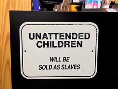 Unattended Children (cowyeow) Tags: american sign funny funnysign shop store desk odd losangeles california us usa city urban slaves slave slavery child children cruel punishment sold humantrafficking