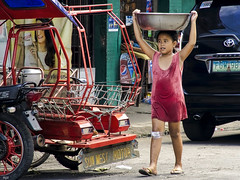 Carrier (Beegee49) Tags: girl wet dress filipina carrying bowl street bacolod city philippines