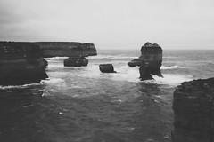 Something Bigger, Something Brighter (Swebbatron) Tags: australia 2008 victoria portcampbell greatoceanroad blackandwhite mono travel razorback lochardgorge radlab fuji seascape ocean sea moody cliffs