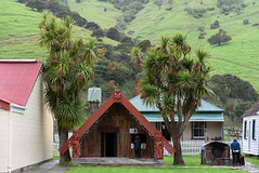 Meeting House (Jocey K) Tags: newzealand nikond750 southisland bankspenisnsula spring maoricolonialmuseumokainsbay museum landsape sky clouds mist hills building architecture people cabbagetrees meetinghouse whaakata maoricarvings cottages okainsbay