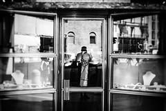 The Jeweler (ewitsoe) Tags: italy man window jeweler shop store front monochrome blackandwhite nikon 35mm stret city urban shoppe italian bologna beautiful moment strret life living ewitsoe erikwitsoe