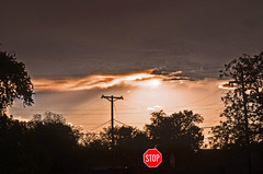 Stop (sundero) Tags: roswell newmexico sunset stopsign telephonepole clouds
