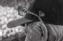 Cool Specs (Wes Iversen) Tags: chicago chicagocubs hmbt illinois monochromebokehthursday nikkor18300mm wrigleyfield wrigleyville crowds glasses hair hats men monochrome people reflections refractions