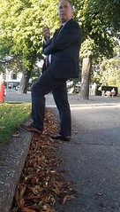 Mr. Cocky - Smoking Businessman 11 (TBTAOTW2011) Tags: hidden camera candid photo businessman business man suit tie pants brown tan leather dress shoe shoes feet foot wingtips wingtip daddy dad belly mature old smoking cigar cigarette grey hair