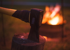 ~The fire is the main comfort of the camp... (Fire Fighter's Wife {off for awhile}) Tags: fire bonfire camping camp campfire axe dark moody lighting lightandshadow dusk sunset matte muted dreamy nikon nikond750 pentacon1850mm pentacon50mmf18 pentacon vintage vintageprocessing vintagelens vintagestilllife retroprocessing outdoors outside country countryside