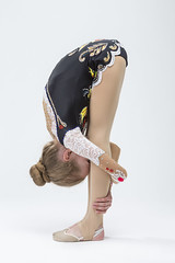 Sport concepts and Ideas. Young Caucasian Female Rhythmic Gymnast Athlete In Professional Competitive Suit Doing Backbend Stretching Exercise While Posing in Studio Against White. (DmitryMorgan) Tags: 1 711years active aerobics art artistic athlete beautiful bend body bodysuit caucasian champion child childhood colorful dynamic elegant exercise female fitness flexible gimnastika girl grace gymnast gymnastics healthy individual lady lifestyle one preschooler professional rhythmic rhythmicgymnastic rhytmic split splits sport sportswear sportswoman sporty stretching studio training wellbeing wellness