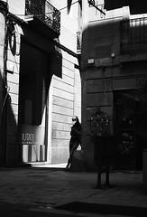 Waiting in the dark (elgunto) Tags: people street elborn barcelona highcontrast light shadows phone waiting texting blackwhite bw monochrome silhouette sonya7 pentax 40mm28 pancake manuallense