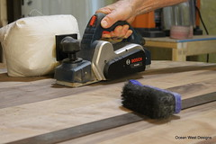 To take out the high spots on the oval table top, I'm using a planer to do that. Then, sanding to give it the final touch before applying the finish. (Ocean West Designs) Tags: moderntable modern diningroom woodtable walnuttable ovaltable customwoodwork kitchentable sawdust decoratingideas finewoodworking wooddesign diningtable woodworker customfurniture craftsmanship carpenter designing hgtv smallbusiness furnituredesign woodworking table handcrafted furniture wood marketing interiordesign success