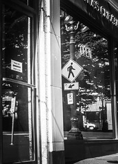 Reflections Of (TMimages PDX) Tags: iphoneography photography image photo photograph streetscene fineartphotography geotagged urban city street streetphotography portland pacificnorthwest sidewalk buildings avenue blackandwhite monochrome vignette window storefront reflection glass