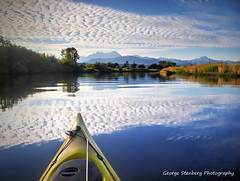 Floating on Reflections (George Stenberg Photography) Tags: washingtonstate pacificnorthwest hoodcanal skokomishriver clouds blue kayaking kayak reflections calmwater quiet