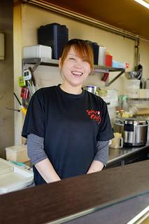 Smiling yakitori girl