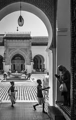 Candy (Cruz-Monsalves) Tags: fez fes mezquita morocco marruecos qarawiyyin child children niño niños candy blackwhite bw muslim arab mosque religion islam islamico islamic people woman inside university art tradition tradición tradicional world feel time door puerta africa arte