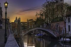 Venetian paths 39 (Maurizio51( nonno ter)) Tags: venice venezia city cityscape architecture water italy sunset sun reflections nikon