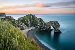 Durdle Door at Sunrise (thomasharrisphotography) Tags: purple dorset landscape landscapephotography landscapes sunrise sunset sun sunshine summer sea seafront beach longexposure nikon manfrotto leefilters clouds photography grass water horizon sky skyline uk england durdledoor lulworthcove sunny blue green orange colours colors colour color nikkor 35mm