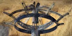 Erector set on display in a storefront window (Explore 7-1-17) (David DeCamp) Tags: circle antique wheel retro texture minoltarokkorx50mmf14 erectorset imagination