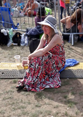 Demure (Reinardina) Tags: southampton england thecommon letsrock music festival concert people sunshine fun street photography woman resting demure summer hat maxidress