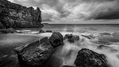 Wet ..! (Einir Wyn Leigh) Tags: blackandwhite building seascape ocean sea water rocks monochrome mono nikon beach wales cymru sky moody