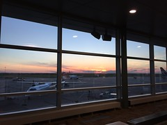 Sunset over Edmonton International Airport (peggyhr) Tags: peggyhr eia evening sunset planes window clouds edmonton alberta canada airport