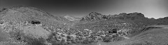 Panorama black and white shot of mountains and desert ghost town (taharaja) Tags: cactus california deathvalley desert furnacecreek ghosttown jeeping lowestpoint nationalpark offroad oldtown racetrack sealevel zabriskiepoint lakebed movingstones slatflats