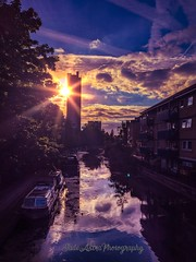 Towering Sunset (JadeAstraPhotography) Tags: sunbeam sun picture photo nottinghill architecture photography iphone london towerblock highrise houseboat shadowandlight reflections colours water brutalist brutalistarchitecture clouds sunset regentscanal trellicktower