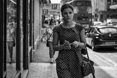Spotted! (Leanne Boulton) Tags: urban street candid portrait portraiture streetphotography candidstreetphotography candidportrait streetportrait eyecontact candideyecontact streetlife woman female girl face facial expression eyes look emotion feeling mood atmosphere stare spotted spotty polkadot dress tone texture detail depthoffield bokeh naturallight outdoor light shade shadow city scene human life living humanity society culture people canon canon5d 5dmkiii 70mm character ef2470mmf28liiusm black white blackwhite bw mono blackandwhite monochrome glasgow scotland uk