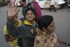 AsiaBikes2-1 (Trev Thompson) Tags: asia boy child culture family happy india indian jodhpur lookingatthecamera motionblur motorscooter panning passengers rajasthan smiling streetscene transport waving