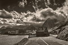 Wellcome to Italy. The wind is blowing on the Italien side of the Great Saint Bernard Pass.(2,469 alt. )Mont Forchon is under a storm. No. 2132. (Izakigur) Tags: liberty izakigur flickr feel europe europa dieschweiz d700 italy italia nikond700 nikkor nikkor2470f28 blackwhite ch helvetia lasuisse musictomyeyes nikon swiss suiza suisia european suisse schweiz romandie suizo svizzera سويسرا laventuresuisse ilpiccoloprincipe thelittleprince שווייץ myswitzerland gransanbernardo grossersanktbernard greatstbernardpass coldugrandsaintbernard coldumontjoux grosserstbernhard lepetitprince colledelgransanbernardo montmort clouds via viafrancigena