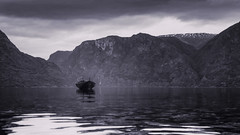 My tiny boat (Tommy Høyland) Tags: noruega landscape nature bnw aurland outdoor one water view norge fjord reflection norway norvegen flåm nobody aurlandsfjorden dark alone lonely bw boat fishingboat tourism black white photo mountain blackandwhitephoto