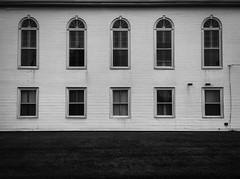 window shopping (sephrocker) Tags: architecture iphonese windows church blackandwhite mono monochromatic silverefx linesandcurves dark