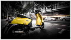 Scooter (Jaka Pirš Hanžič) Tags: brisbane queensland qld australia street city scooter motion movement colour color selective desaturated moving lights bright daylight day morning urban blur tiltshift photoshop yellow vehicle transport traffic trails