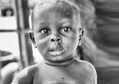 See it in my eyes (Ram Iyer Photography) Tags: face blackwhite faces street streetphotography streetart africa kenya tanzania road portrait blackandwhite nationalgeographic natgeo ramiyer ramiyerphotography boy kids sparkling eyes innocent innocence