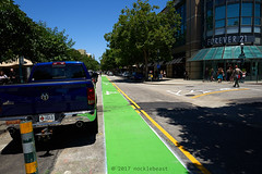Santa Cruz Public Works says that there's a two foot buffer between parked cars and the bike lane (yeah, right), but the reality is that (nocklebeast) Tags: nrd pacificavenue contraflow bikelane green santacruz streets ca usa semperfi