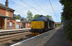 Europhoenix 37611 roars through Mistley, on the Harwich Branch, on a Norwich - Colchester route learner, via Gt Yarmouth, Harwich & Clacton. 26 06 2017 (pnb511) Tags: train trains loco locomotive class37 track overhead cables platfoms station harwichbranch le lightengine