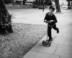 Scooter (davidwoganphoto) Tags: 21mm 64 sony a6300 blackandwhite boy camden davidwogan fast film kodak london monochrome moving pancras road school scooter simulation street trix vm voigtlander england unitedkingdom gb