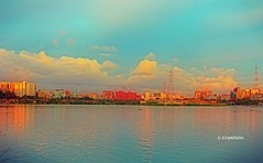 A portion of Hatirjheel Lake (ChandrahaasCreation) Tags: light lighting lights look lens love landscape life lovely less lake dslr day daylight digital different dhaka design decorate dhakacity cannon color close camera cool colorful contrast colors city red river refresh round buildings building golden gulshan niketon sky soft sunlight shine sun sculpture