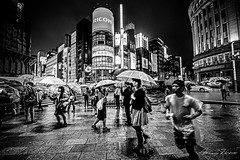 Stopping Time (Mario Rasso) Tags: mariorasso japan japon tokyo tokio asia street streetphotography urban urbano rain raining umbrella people nikon