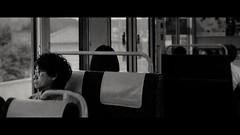 Nara to Kyoto, Japan (emrecift) Tags: candid portrait street japan train travel analog 35mm film photography bw monochrome cinematic grain 2391 anamorphic crop canon ae1 program new fd 50mm f14 kodak tmax 100 ilfosol 3 114 emrecift filmdev:recipe=11479 kodaktmax100 ilfordilfosol3 film:brand=kodak film:name=kodaktmax100 film:iso=100 developer:brand=ilford developer:name=ilfordilfosol3