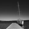Alone at the jetty (OzzRod) Tags: pentax k1 smcpentaxda18135mmf3556 monochrome blackandwhite lake sky boat yacht jetty calm serence warnersbay lakemacquarie dailyinjuly2017