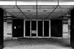 un-cooperative (Harry Halibut) Tags: 2017©andrewpettigrew allrightsreserved contrastbysoftwarelaziness noiretblanc blackwhite blancoynegro blanc weiss noire schwatz bw zwart wit bianco nero branco preto imagesofsheffield images sheffieldarchitecture sheffieldbuildings south yorkshire sheff1706252383 empty buiulding entrance canopy doors furnival gate cooperative store