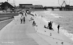 People watching (jane.hards) Tags: blackpool blackpoolpromenade seaside british britishsummer lancashire people ferris wheel pier iconic holiday timeout blackandwhite group timeless outdoor contrast shadows