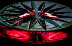 Starfire (Bottom of Cut-Glass Vase) (really_late_bloomer) Tags: macromonday bottomsup red glass star fire starfire cutglass light crystal dantesinferno paradiso truenorth compass