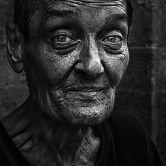 Old lady (Ales Dusa) Tags: lady woman homeless face portrait streetportrait streetshot closeupportrait bw monochrome blackandwhite alesdusa canon5d strongcontrast oldies oldlady people candideyecontact ef50mmf18 naturallight outdoor city detail facial look human candidportrait aged expression eyes streetlife emotion feeling mood humanity storytelling charisma