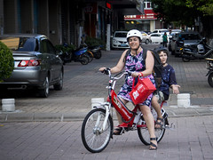 On yer Bike (C & R Driver-Burgess) Tags: 电车 妈妈 儿子 孩子 路 购物袋 家 mother son electric bike bicycle shopping bag ride family red 红色