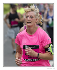Windswept (Seven_Wishes) Tags: newcastleupontyne gateshead tyneandwear outdoor photoborder canoneos5dmarkiv canonef100400mmf4556lisii simplyhealth10k roadrace 10krace people candid portrait street runner running dof depthoffield sportingevent athlete athletic blonde pink windswept puma sueroberts